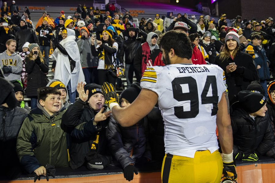 Iowa+fans+greet+Iowa+defensive+end+A.J.+Epenesa+after+the+Iowa%2FIllinois+football+game+at+Memorial+Stadium+in+Champaign+on+Saturday%2C+November+17%2C+2018.+The+Hawkeyes+defeated+the+Fighting+Illini%2C+63-0%2C+to+snap+a+3-game+losing+streak.+