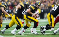 Iowa quarterback Nate Stanley looks to pass the ball during the Iowa/Nebraska football game at Kinnick Stadium on Friday, November 23, 2018. The Hawkeyes defeated the Huskers, 31-28, with a last second field goal.