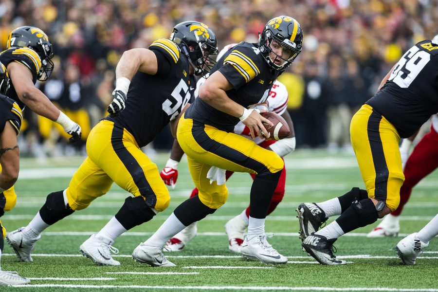 Iowa+quarterback+Nate+Stanley+looks+to+pass+the+ball+during+the+Iowa%2FNebraska+football+game+at+Kinnick+Stadium+on+Friday%2C+November+23%2C+2018.+The+Hawkeyes+defeated+the+Huskers%2C+31-28%2C+with+a+last+second+field+goal.+