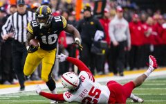 Iowa running back Mekhi Sargent sheds Nebraska safety Antonio Reeds tackle during the Iowa/Nebraska football game at Kinnick Stadium on Friday, Nov. 23, 2018. The Hawkeyes defeated the Huskers, 31-28, with a last-second field goal.