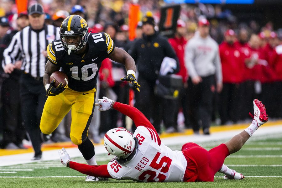 Iowa+running+back+Mekhi+Sargent+sheds+Nebraska+safety+Antonio+Reed%27s+tackle+during+the+Iowa%2FNebraska+football+game+at+Kinnick+Stadium+on+Friday%2C+Nov.+23%2C+2018.+The+Hawkeyes+defeated+the+Huskers%2C+31-28%2C+with+a+last-second+field+goal.+
