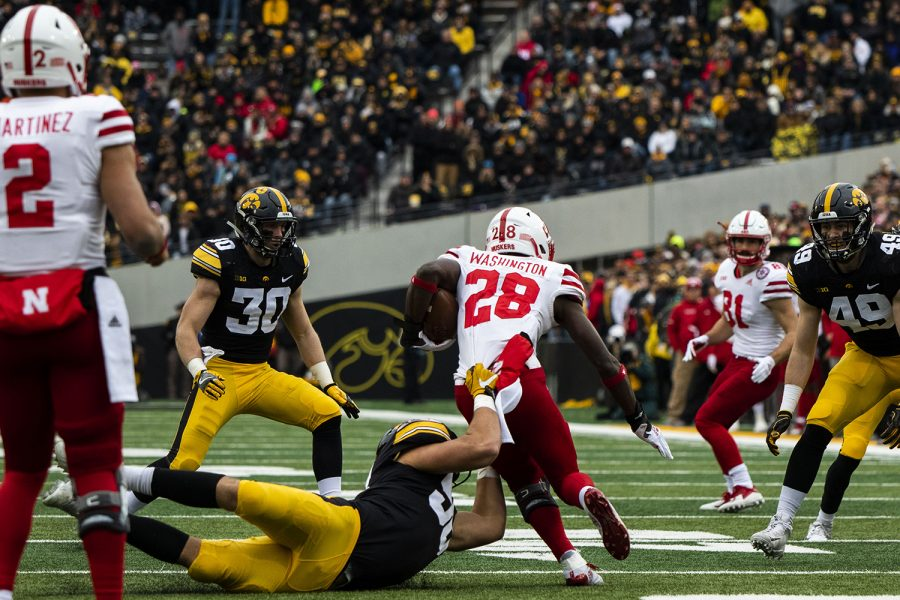 Iowa+defensive+end+Anthony+Nelson+attempts+to+bring+down+Nebraska+running+back+Maurice+Washington+during+the+Iowa%2FNebraska+football+game+at+Kinnick+Stadium+on+Friday%2C+November+23%2C+2018.+The+Hawkeyes+defeated+the+Huskers%2C+31-28%2C+with+a+last+second+field+goal.+