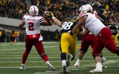 Iowa defensive end Anthony Nelson attempts to stop Nebraska quarterback Adrian Martinez pass during the Iowa/Nebraska football game at Kinnick Stadium on Friday, November 23, 2018. The Hawkeyes defeated the Huskers, 31-28, with a last second field goal.
