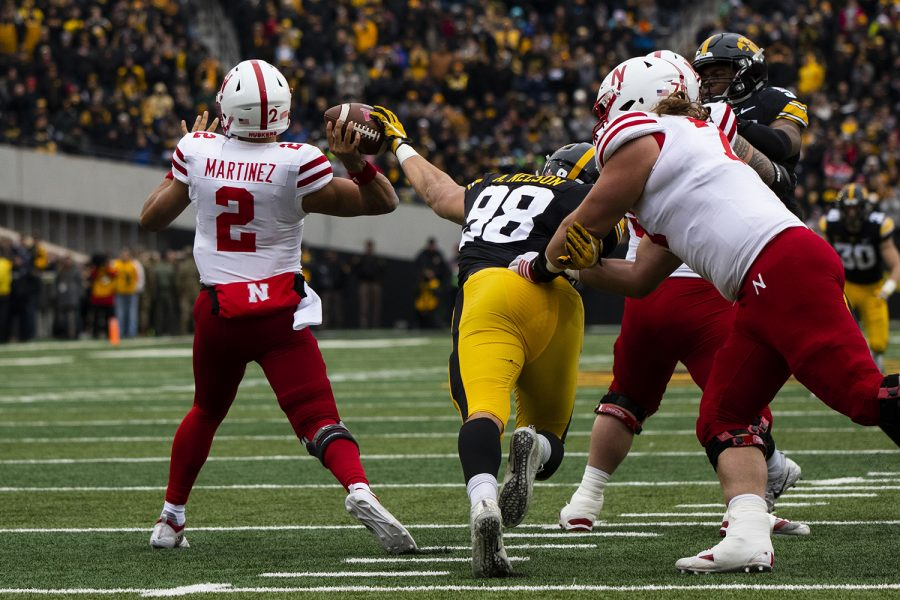 Iowa+defensive+end+Anthony+Nelson+attempts+to+stop+Nebraska+quarterback+Adrian+Martinez%27+pass+during+the+Iowa%2FNebraska+football+game+at+Kinnick+Stadium+on+Friday%2C+November+23%2C+2018.+The+Hawkeyes+defeated+the+Huskers%2C+31-28%2C+with+a+last+second+field+goal.+