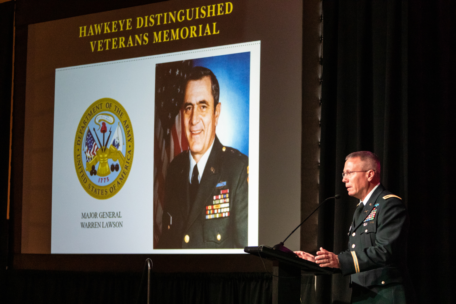 Col. David Nixon of the Iowa Army National Guard receives a Hawkeye Distinguished Veteran's Award on behalf of Maj. Gen. Warren Lawson at the IMU on Thursday, Nov. 15, 2018. Lawson played center for the Iowa football team as an undergrad and was the team's MVP in 1954.