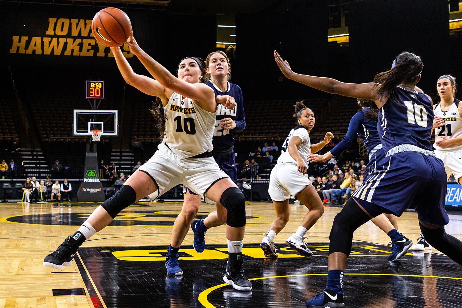 Iowa forward Megan Gustafson (10) fights for an offensive rebound during a women's basketball game against Oral Roberts University on Friday, Nov. 9, 2018. The Hawkeyes defeated the Golden Eagles 90-77.