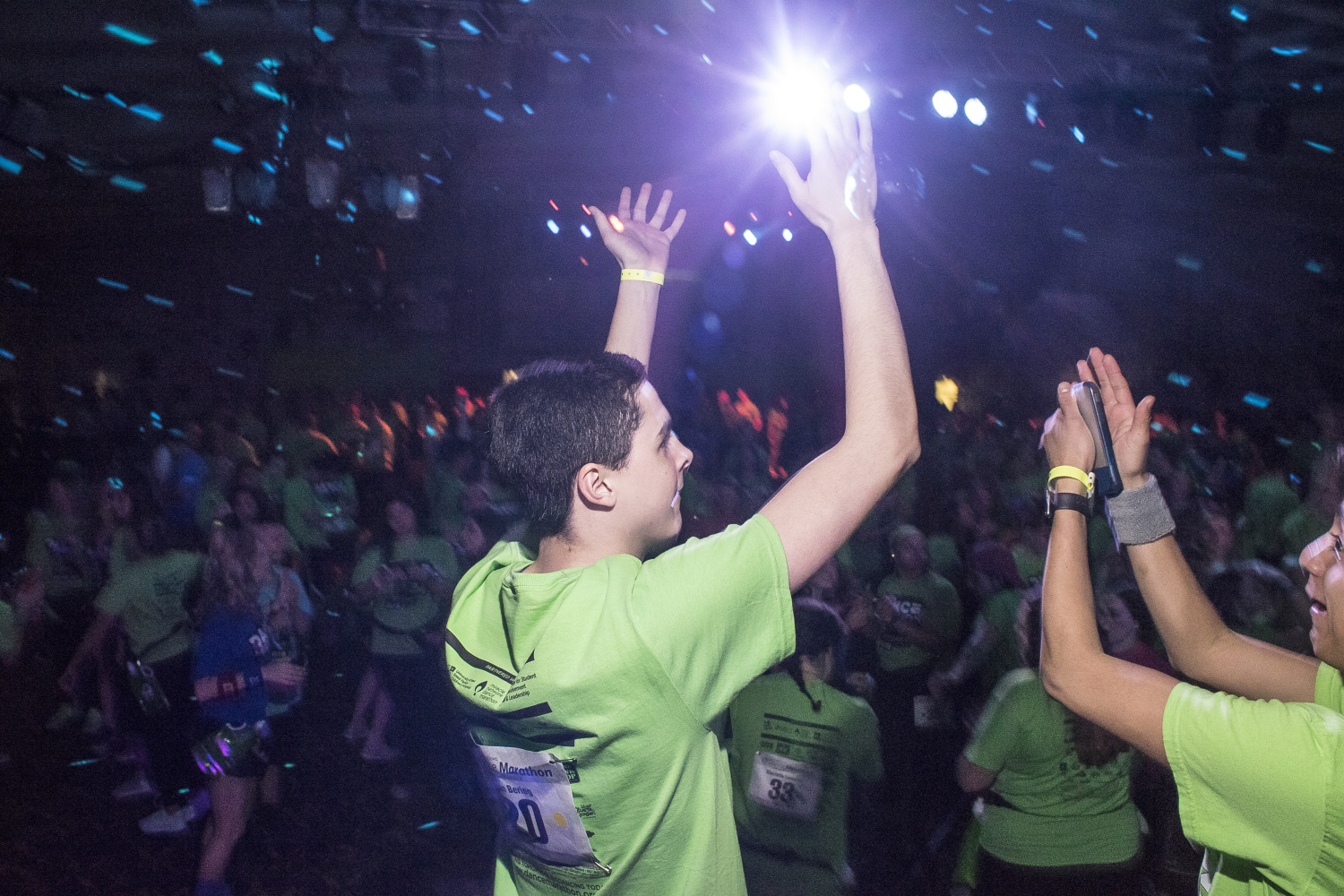 Dancers on the stage motivate the crowd at Dance Marathon in the Iowa Memorial Union on Friday, Feb. 2, 2018. (James Year/The Daily Iowan)