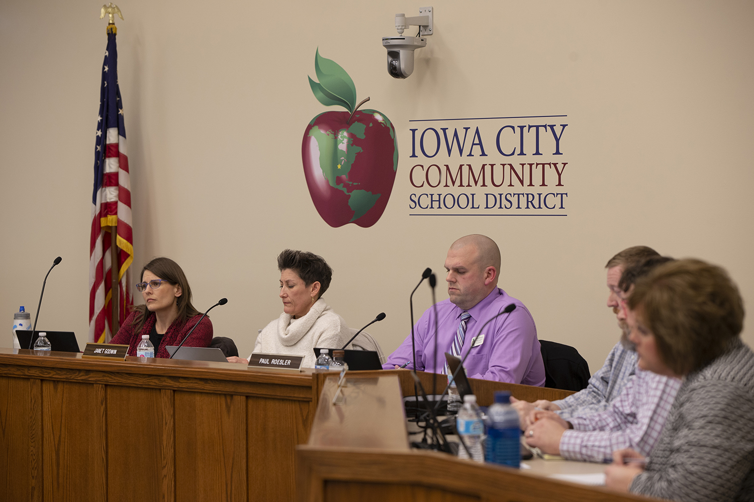 School Board members listen as people raise concerns about school rezoning at the School District Administration Building on Tuesday. At the meeting, board members voted to redraw school zones in an effort to create a more equitable learning system.