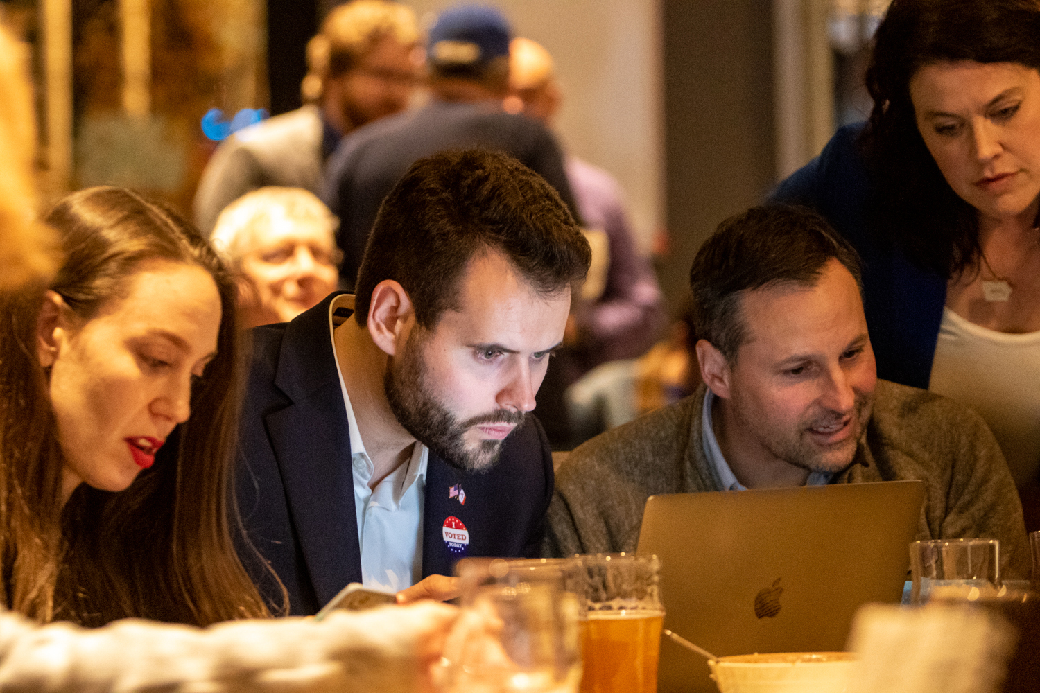 Iowa Senate Democratic Candidate Zach Wahls watches election results on his laptop during an election night watch party at Big Grove Brewery in Iowa City on Tuesday, Nov. 6, 2018.