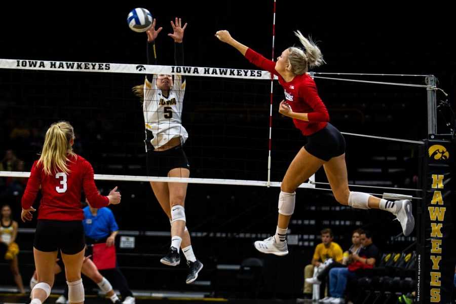 Outside+hitter+Meghan+Buzzerio+jumps+to+block+a+spike+during+Iowa%27s+game+against+Nebraska+at+Carver-Hawkeye+Arena+on+Nov.+7%2C+2018.+The+Hawkeyes+were+defeated+0-3.
