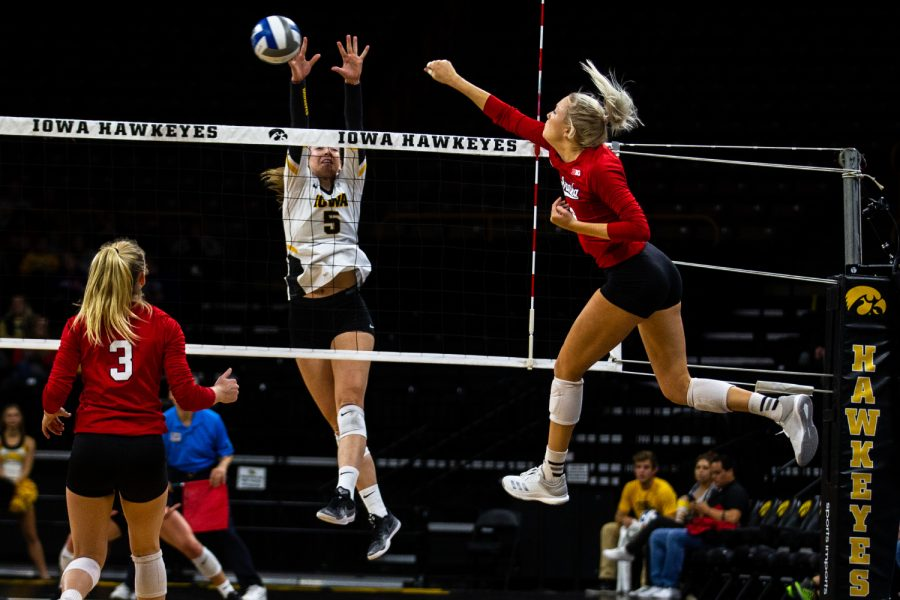 Outside+hitter+Meghan+Buzzerio+jumps+to+block+a+spike+during+Iowa%27s+game+against+Nebraska+at+Carver-Hawkeye+Arena+on+November+7%2C+2018.+The+Hawkeyes+were+defeated+0-3.