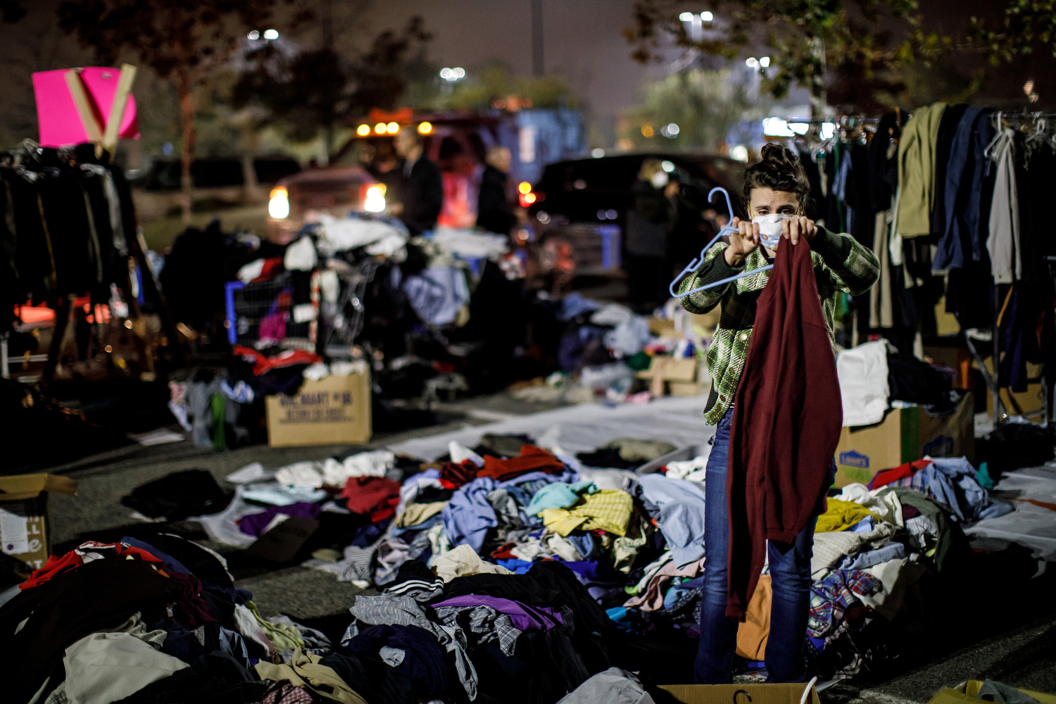 Jessica Sijan, whose family is from Paradise and lost everything to the Camp Fire, volunteers to sort out clothes for evacuees gathered at a Walmart parking lot in Chico, Calif., on Tuesday, Nov. 13, 2018. (Marcus Yam/Los Angeles Times/TNS)