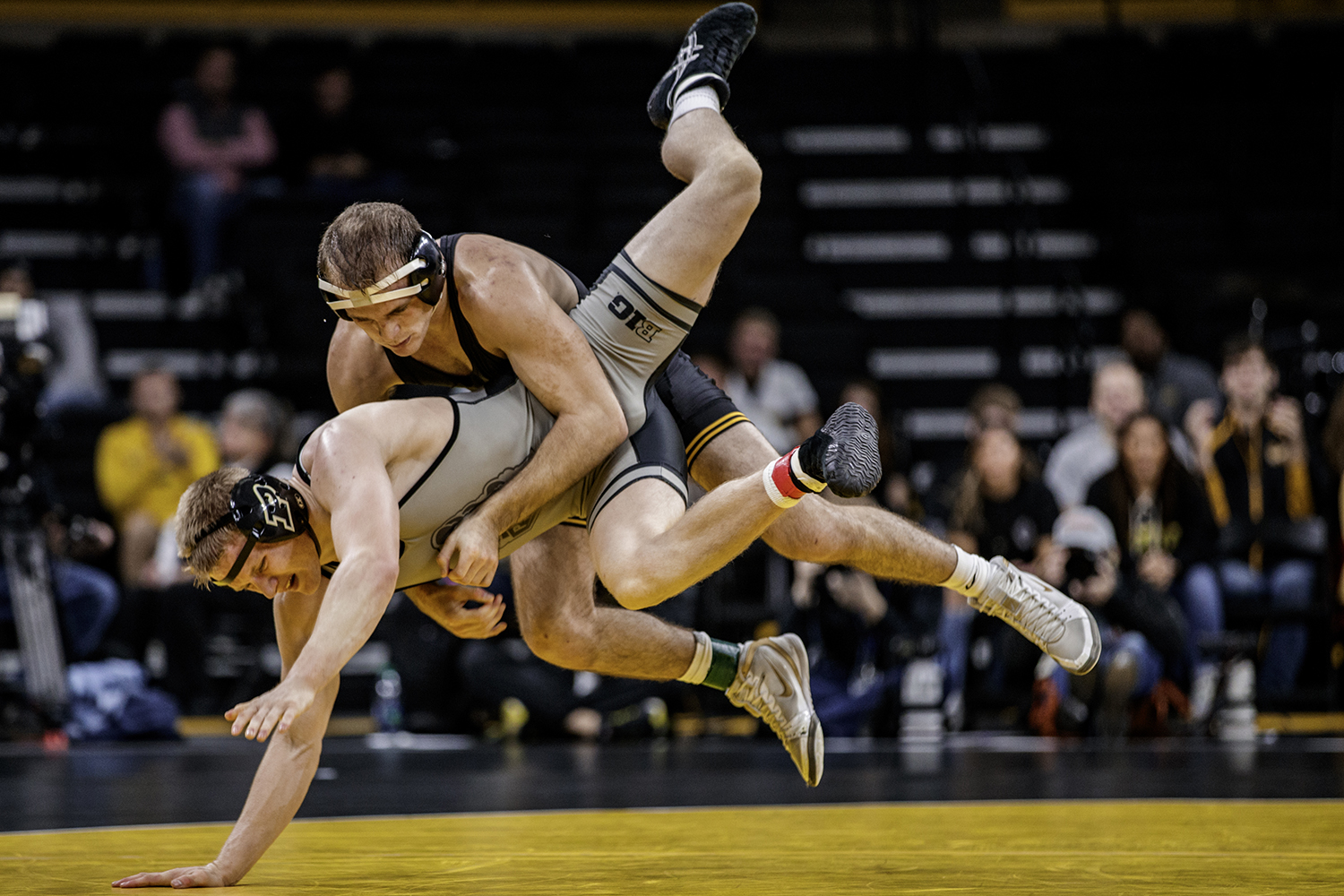 Iowa's Carter Happel takes down Purdue's Parker Filius during Iowa's dual meet against Purdue at Carver-Hawkeye Arena in Iowa City on Saturday, Nov. 24, 2018. Happel defeated Filus 2-0 and The Hawkeyes defeated the Boilermakers 26-9.