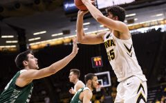 Iowa's Luka Garza shoots a jumper at the beginning of the first half during the Iowa Vs. Green Bay basketball game. The Hawkeyes won 93-83 at Carver-Hawkeye Arena on Nov. 11.