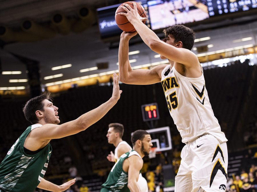 Iowa%E2%80%99s+Luka+Garza+shoots+a+jumper+at+the+beginning+of+the+first+half+during+the+Iowa+Vs.+Green+Bay+basketball+game.+The+Hawkeyes+won+93-83+at+Carver-Hawkeye+Arena+on+Nov.+11.