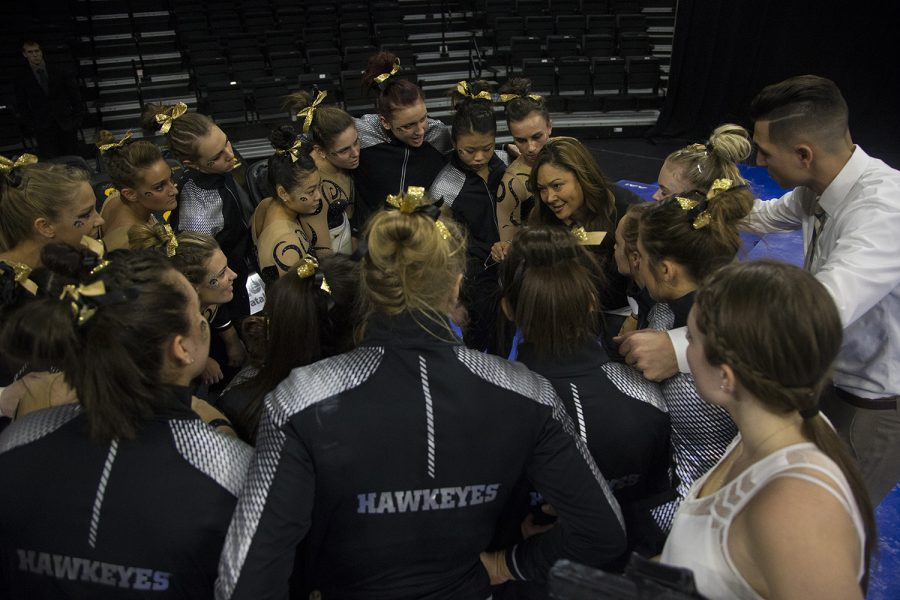 Iowa head coach Larissa Libby huddles with her athletes during a women's gymnastics meet in Carver-Hawkeye Arena on Friday, Jan. 13, 2017.