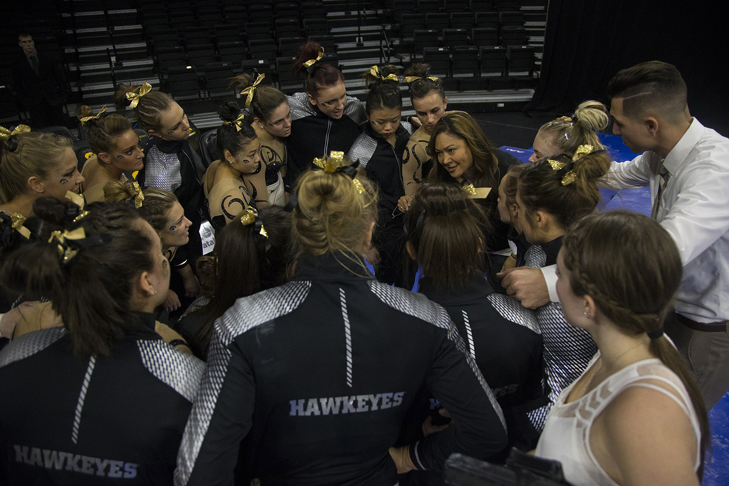 Iowa head coach Larissa Libby huddles with her athletes during a women's gymnastics meet in Carver-Hawkeye Arena on Friday, Jan. 13, 2017. The Hawkeyes defeated the Spartans, 195.475-193.875.
