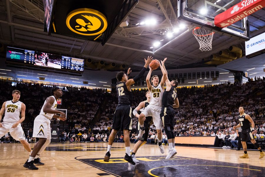 Iowa+Forward+Nicholas+Baer+attempts+a+jump+shot+during+a+game+against+Purdue+University+on+Saturday%2C+Jan.+20%2C+2018.+The+Boilermakers+defeated+the+Hawkeyes+87-64.+