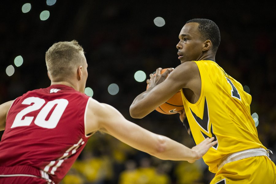 Iowa+guard+Maishe+Dailey+%281%29+looks+for+an+open+pass+around+Wisconsin%27s+T.J.+Schlundt+%2820%29+during+the+NCAA+men%27s+basketball+game+between+Iowa+and+Wisconsin+at+Carver-Hawkeye+Arena+on+Tuesday%2C+Jan.+23%2C+2018.+The+Hawkeyes+are+going+into+the+game+with+a+conference+record+of+1-7.+Iowa+went+on+to+defeat+Wisconsin+85-67.+