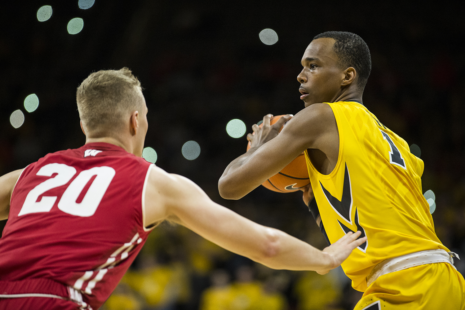 Iowa guard Maishe Dailey (1) looks for an open pass around Wisconsin's T.J. Schlundt (20) during the NCAA men's basketball game between Iowa and Wisconsin at Carver-Hawkeye Arena on Tuesday, Jan. 23, 2018. The Hawkeyes are going into the game with a conference record of 1-7. Iowa went on to defeat Wisconsin 85-67.