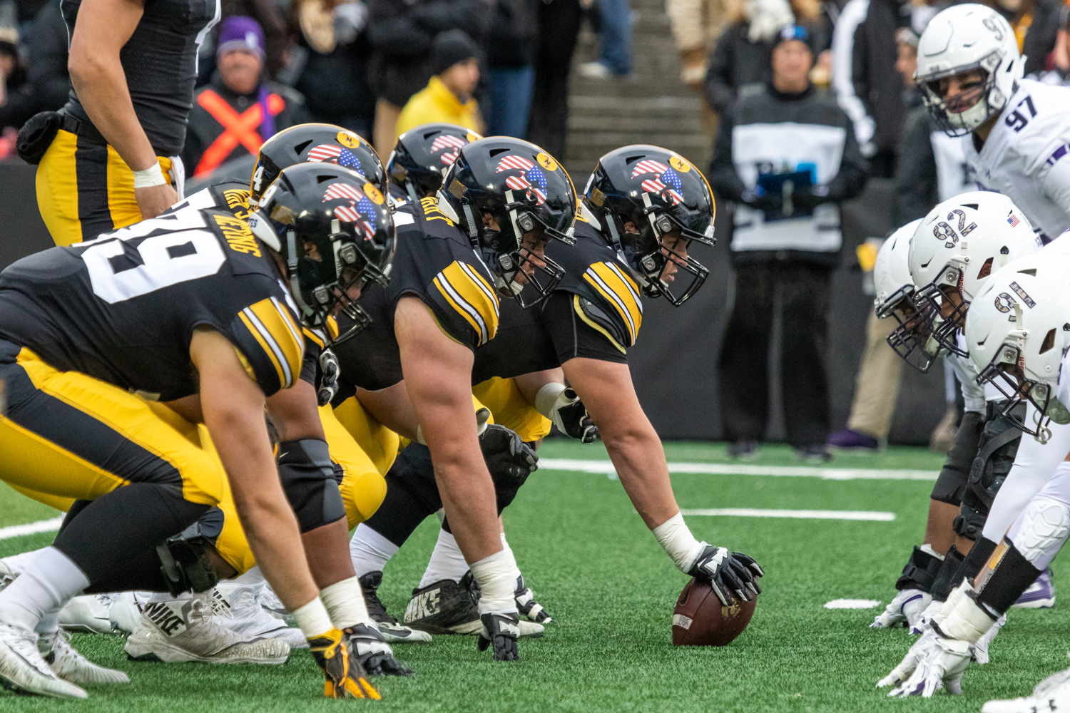 The Iowa offensive line squares up against the Northwestern defense during a game against Northwestern University on Saturday, Nov. 10, 2018 at Kinnick Stadium in Iowa City. The Wildcats defeated the Hawkeyes 14-10.