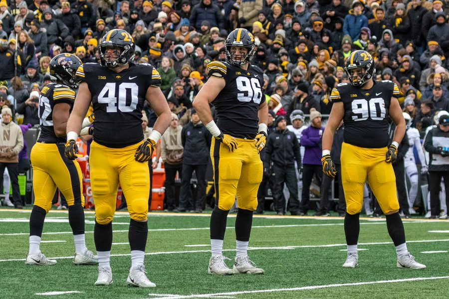 Iowa+defensive+end+Parker+Hesse+%2840%29%2C+Iowa+defensive+end+Matt+Nelson+%2896%29%2C+and+Iowa+defensive+end+Sam+Brincks+%2890%29+look+back+towards+their+bench+during+a+game+against+Northwestern+on+Saturday%2C+Nov.+10+at+Kinnick+Stadium.+The+Wildcats+defeated+the+Hawkeyes+14-10.+