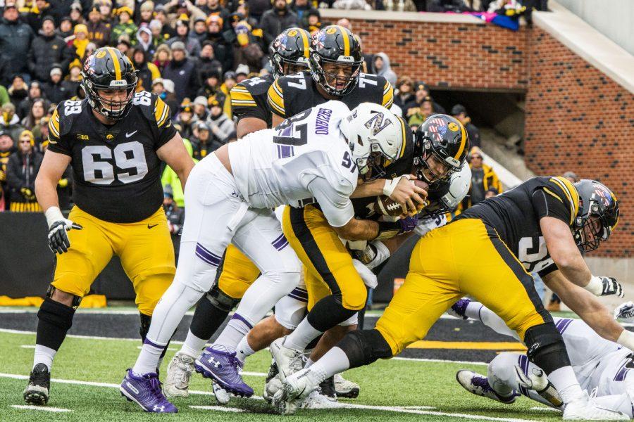 Northwestern+defensive+lineman+Joe+Gaziano+tackles+Iowa+quarterback+Nate+Stanley+during+the+Iowa%2FNorthwestern+game+at+Kinnick+Stadium+on+Saturday%2C+Nov.+10%2C+2018.+The+Wildcats+defeated+the+Hawkeyes+14-10.+