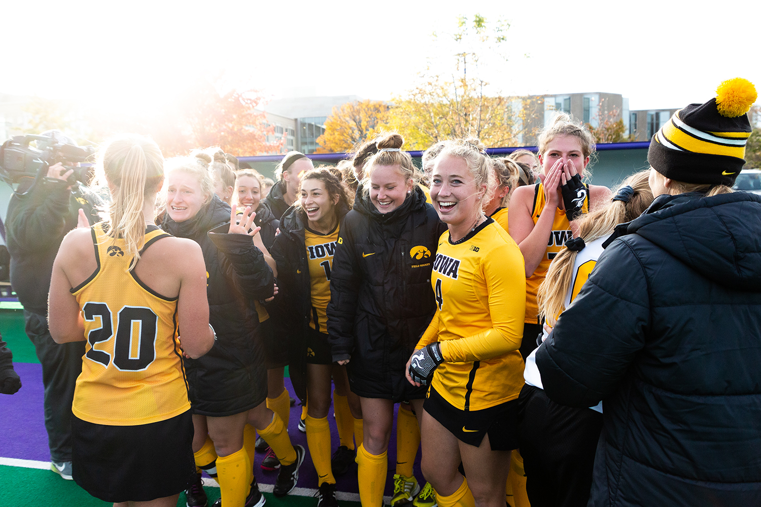 Iowa midfielder Makenna Grewe (center, left) smiles as the Iowa field hockey team celebrates after the Semifinals in the Big Ten Field Hockey Tournament at Lakeside Field in Evanston, Illinois, on Friday, Nov. 2, 2018. The No. 8 ranked Hawkeyes defeated the No. 7 ranked Wolverines 2-1.