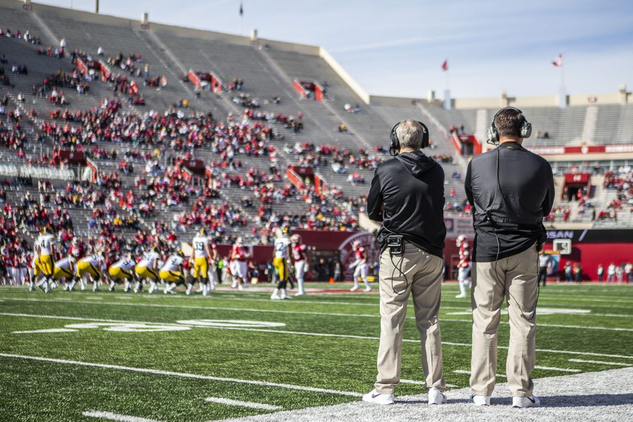 Iowa head coach Kirk Ferentz and offensive coordinator Brian Ferentz watch the game during Iowa's game at Indiana at Memorial Stadium in Bloomington on Saturday, Oct. 13, 2018.