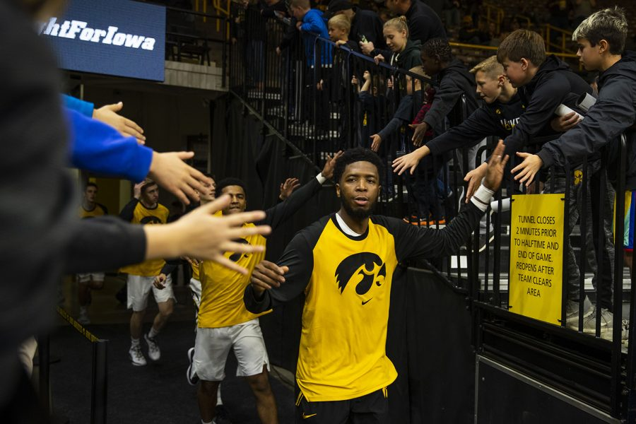 Iowa+guard+Isaiah+Moss+high+fives+fans+during+the+Iowa%2FGuilford+College+basketball+game+at+Carver-Hawkeye+Arena+on+Sunday%2C+Nov.+4%2C+2018.+The+Hawkeyes+defeated+the+Quakers%2C+103-46.+
