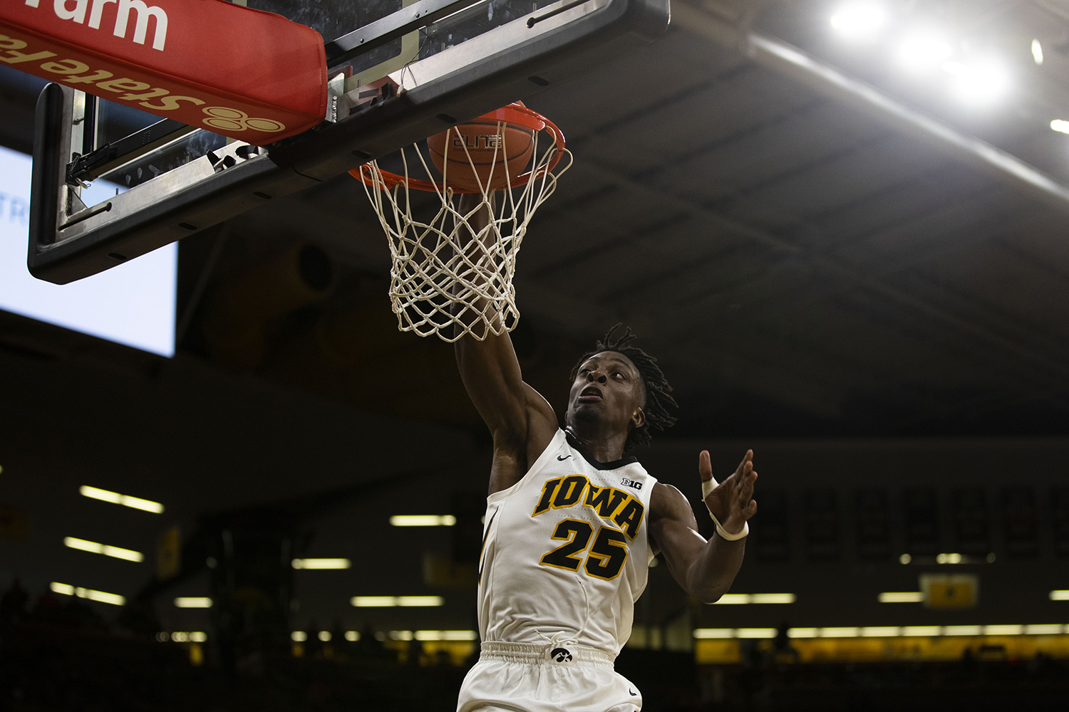 Iowa forward Tyler Cook dunks the ball during the Iowa/Guilford College basketball game at Carver-Hawkeye Arena on Sunday, Nov. 4, 2018. The Hawkeyes defeated the Quakers, 103-46. (Lily Smith/The Daily Iowan)