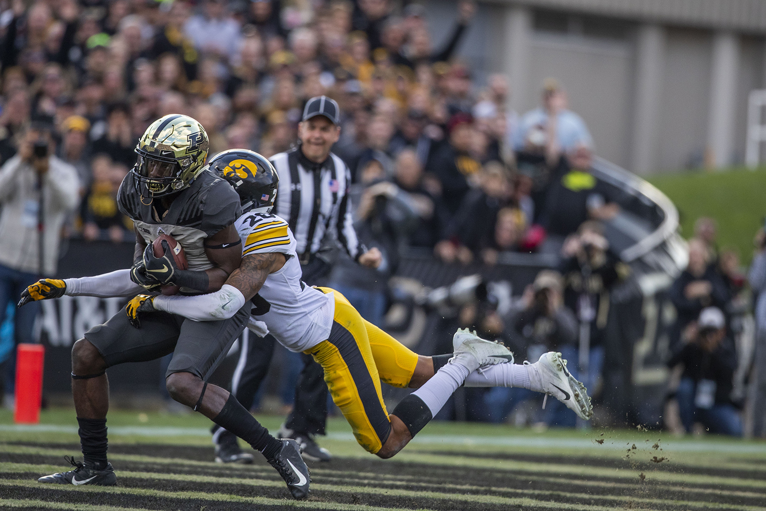 Iowa defensive back Julius Brents tackles Purdue wide receiver Isaac Zico in the end zone during the Iowa/Purdue game at Ross-Ade Stadium in West Lafayette, Ind. The Boilermakers defeated the Hawkeyes, 38-36, with a last second field goal.