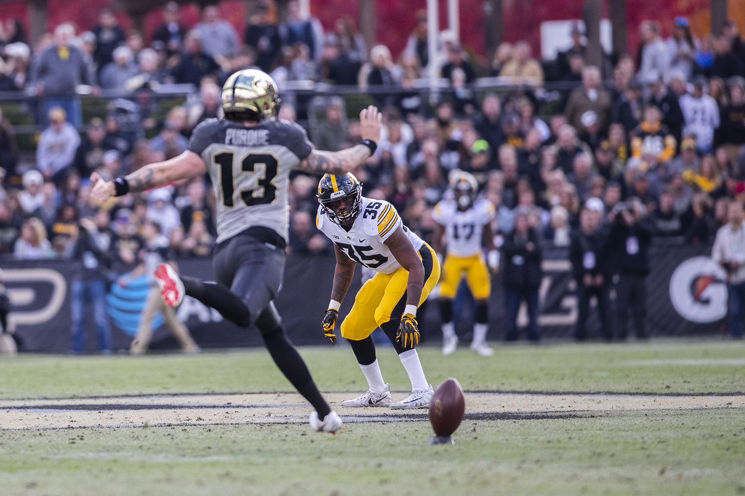 Iowa+linebacker+Barrington+Wade+anticipates+Purdue+kicker+Spencer+Evans%27+kick+during+the+Iowa%2FPurdue+game+at+Ross-Ade+Stadium+in+West+Lafayette%2C+Ind.+The+Boilermakers+defeated+the+Hawkeyes%2C+38-36%2C+with+a+last+second+field+goal.+