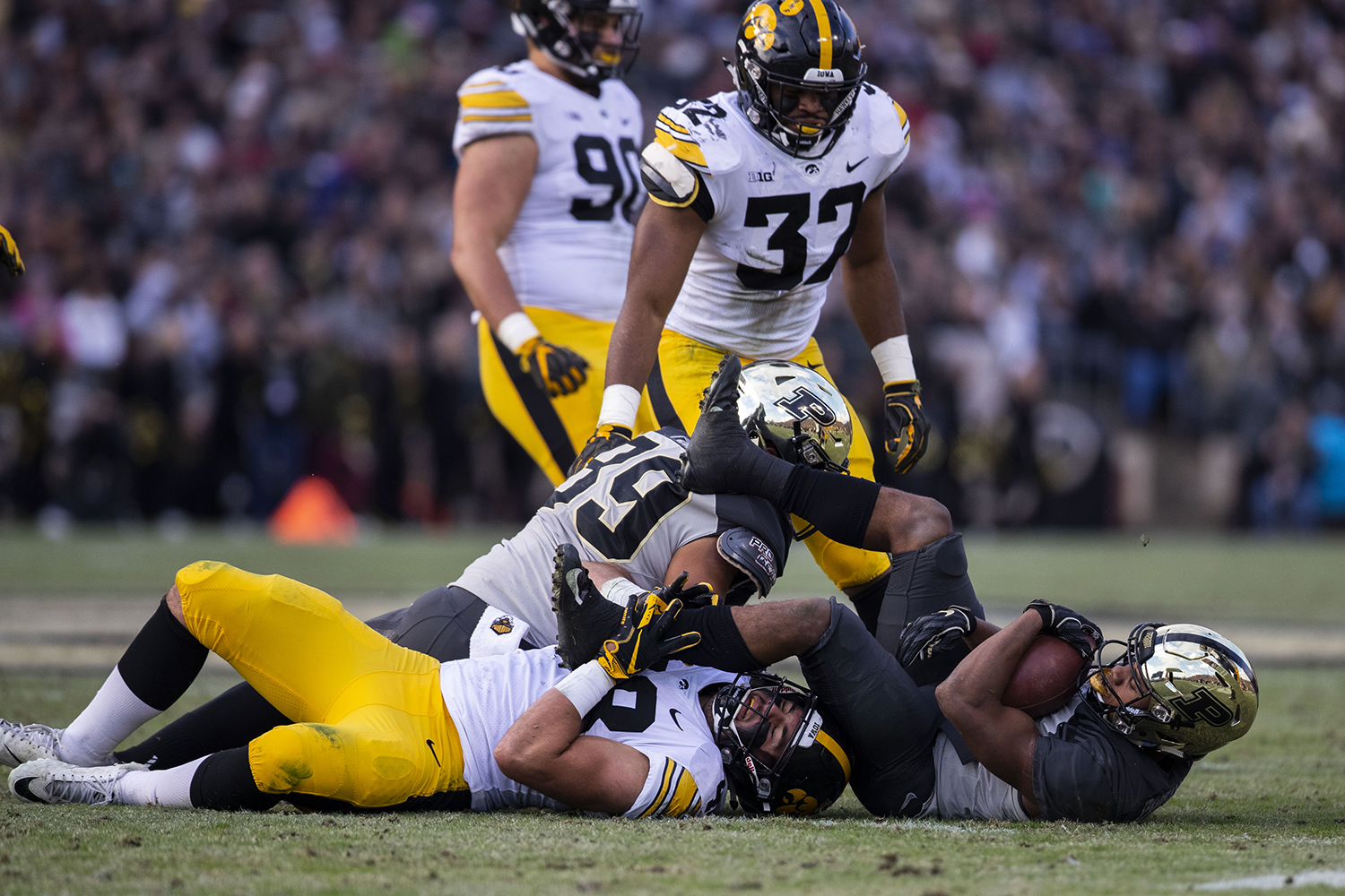 Iowa+running+back+Toren+Young+%2828%29+is+toppled+by+Purdue+offense+during+the+Iowa%2FPurdue+game+at+Ross-Ade+Stadium+in+West+Lafayette%2C+Ind.+The+Boilermakers+defeated+the+Hawkeyes%2C+38-36%2C+with+a+last+second+field+goal.+