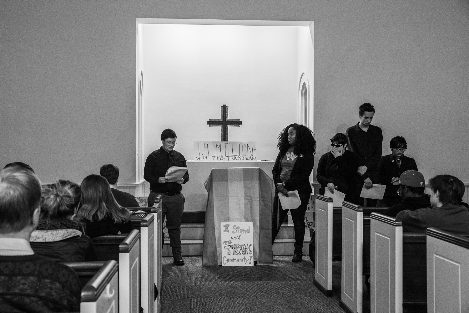 Beck+O%27Brien+reads+the+names+of+trans+people+who+have+died+in+2018+at+Danforth+Chapel+on+Wednesday%2C+Nov.+14%2C+2018.+The+Trans+Day+of+Remembrance+Vigil+is+an+annual+event+thats+occurred+across+the+world+since+1999.+The+event+concluded+with+attendees+writing+messages+on+post-it+notes+that+was+turned+into+a+collage+and+will+be+displayed+at+the+LGBTQ+Resource+Center.