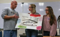 Students present a group project during a One Community, One Book class at the Oakdale prison on Oct. 25. The class is offered once a year through the UI Center for Human Rights.