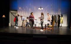 Actors interact and set a table during