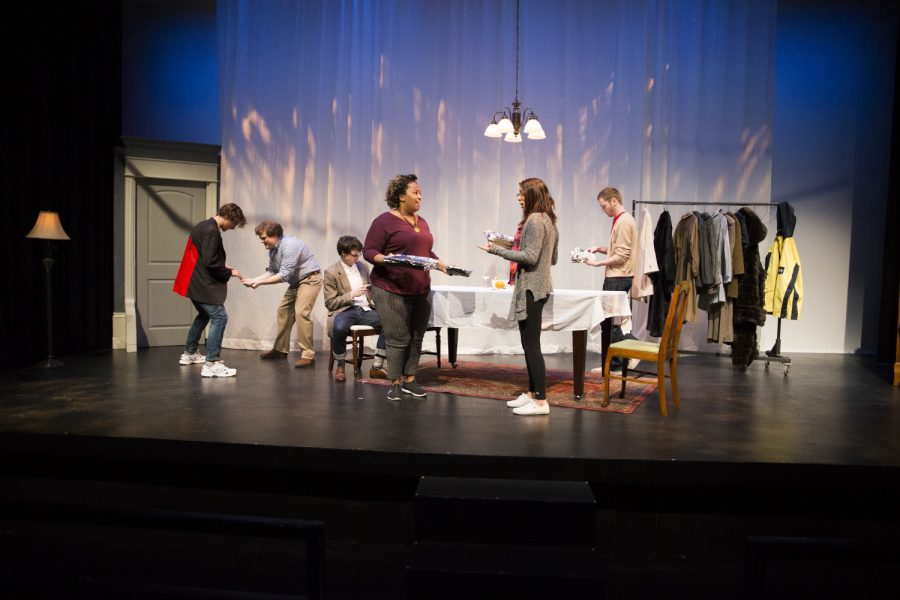 Actors interact and set a table during Why is This Night Different? at the Theater Building on Tuesday, Nov. 27, 2018. The play centers on family drama on Passover.