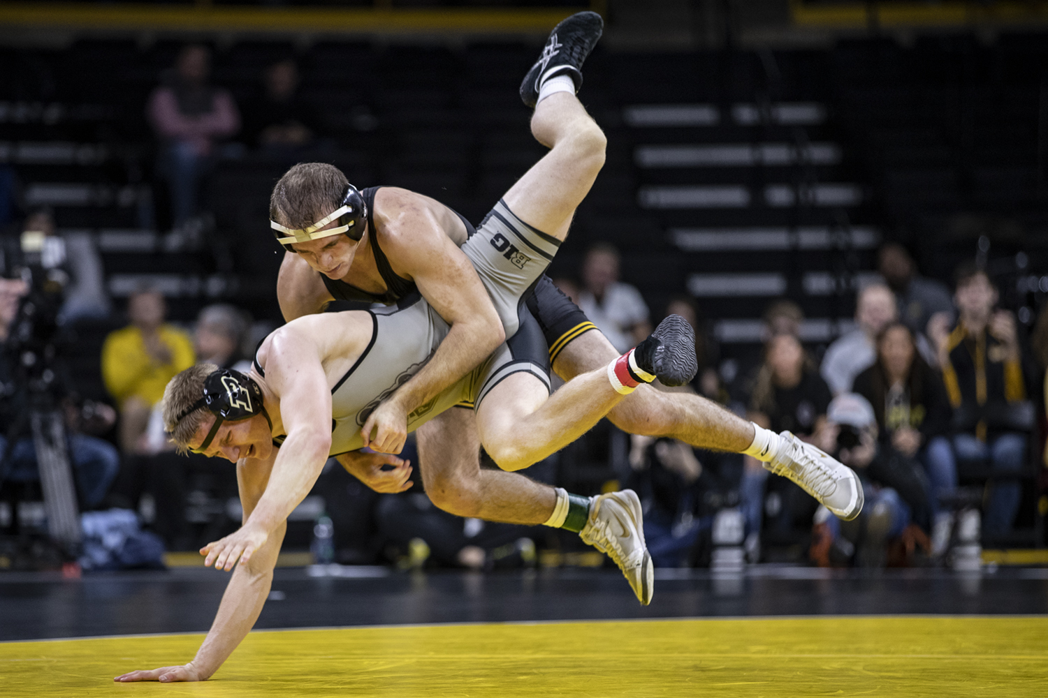 Iowa's Carter Happell wrestles with Purdue's Parker Filius during Iowa's dual meet against Purdue at Carver-Hawkeye Arena in Iowa City on Saturday, Nov. 24, 2018. Happel defeated Filius 2-0 and the Hawkeyes defeated the Boilermakers 26-9.