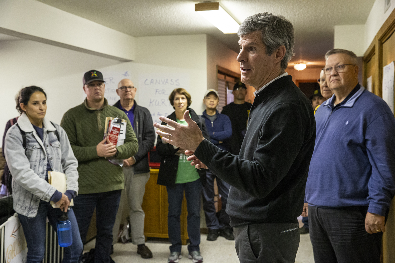 Democratic gubenetorial candidate Fred Hubbell addresses campaign volunteers at a canvassing staging location in the Home of volunteer Janice Wiener on Monday, Nov. 5, 2018.