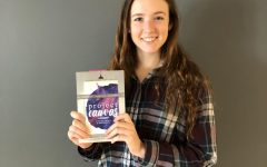 Caroline Meek poses with her book, Project Canvas