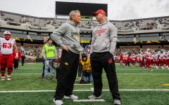Iowa head coach Kirk Ferentz and Nebraska head coach Scott Frost speak before the Iowa vs. Nebraska game on Friday, Nov. 23, 2018. Iowa defeated the Huskers 31-28.