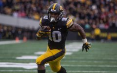 Iowa running back Mehki Sargent carries the ball during the Iowa vs. Nebraska game on Friday, November 23, 2018. Iowa defeated the Huskers 31-28.