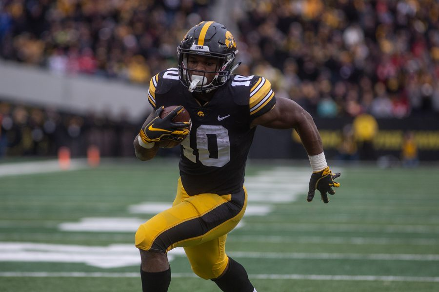 Iowa+running+back+Mehki+Sargent+carries+the+ball+during+the+Iowa+vs.+Nebraska+game+on+Friday%2C+November+23%2C+2018.+Iowa+defeated+the+Huskers+31-28.
