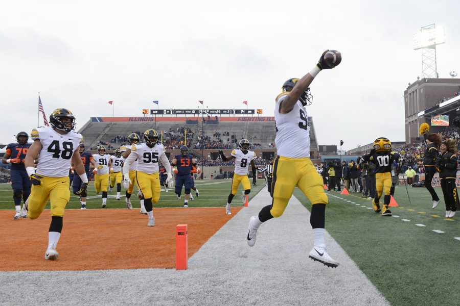 Iowa+defensive+lineman+AJ+Epenesa+celebrates+after+scoring+a+touchdown+on+a+fumble+return+during+Iowa%27s+game+against+Illinois+at+Memorial+Stadium+in+Champaign%2C+IL%2C+on+Saturday%2C+Nov.+17%2C+2018.+The+Hawkeyes+defeated+the+Fighting+Illini+63-0.
