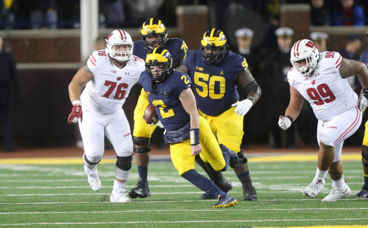 Michigan quarterback Shea Patterson (2) runs the ball against Wisconsin in the first half on Saturday, Oct. 13, 2018, at Michigan Stadium in Ann Arbor, Mich. (Kirthmon F. Dozier/Detroit Free Press/TNS)