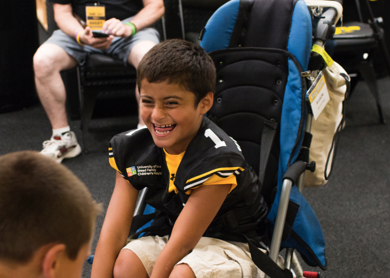 Kid Captain Mason Gonzalez laughs during Iowa Football Kids' Day at Kinnick Stadium on Saturday, Aug 11, 2018.