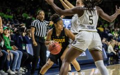 Iowa senior Tania Davis dribbles the ball during a basketball match between Iowa and Notre Dame in South Bend, IN on Thursday, November 29, 2018. The Hawkeyes were defeated by the Fighting Irish, 105-71. (Shivansh Ahuja/The Daily Iowan)