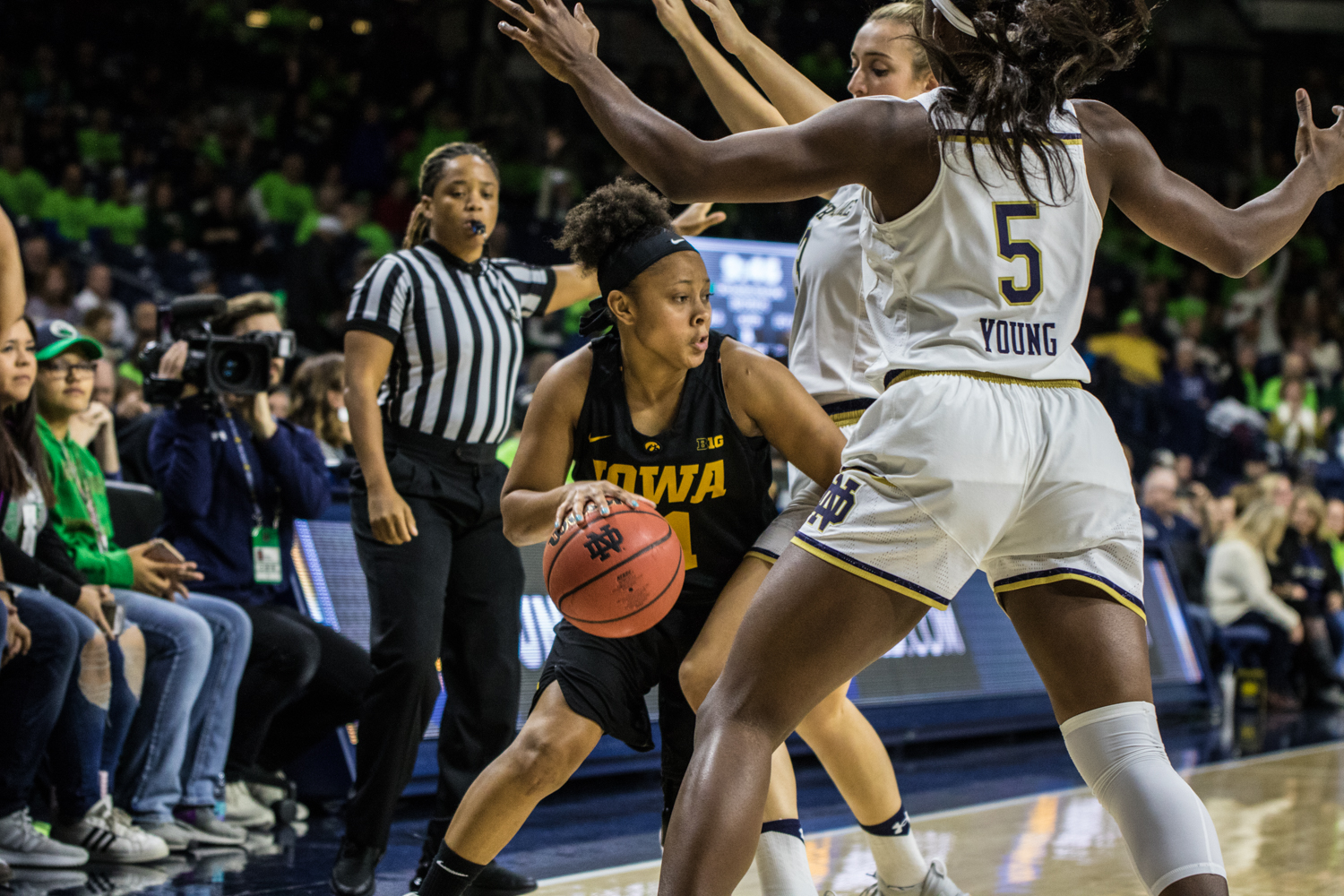 Iowa senior Tania Davis dribbles the ball during a basketball match between Iowa and Notre Dame in South Bend, IN on Thursday, November 29, 2018. The Hawkeyes were defeated by the Fighting Irish, 105-71.