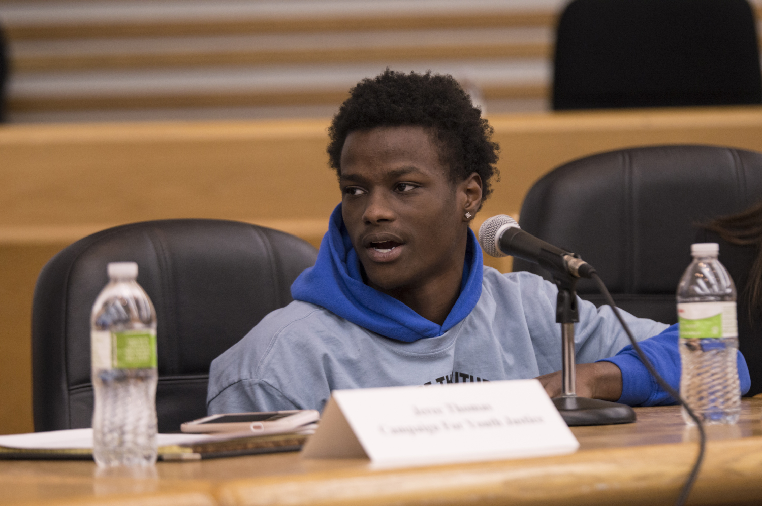 Danish Robertson  speaks during an event at the College of Law. Members of the community gathered to advocate against teenagers being held in adult prisons on Thursday, Nov. 1, 2018.